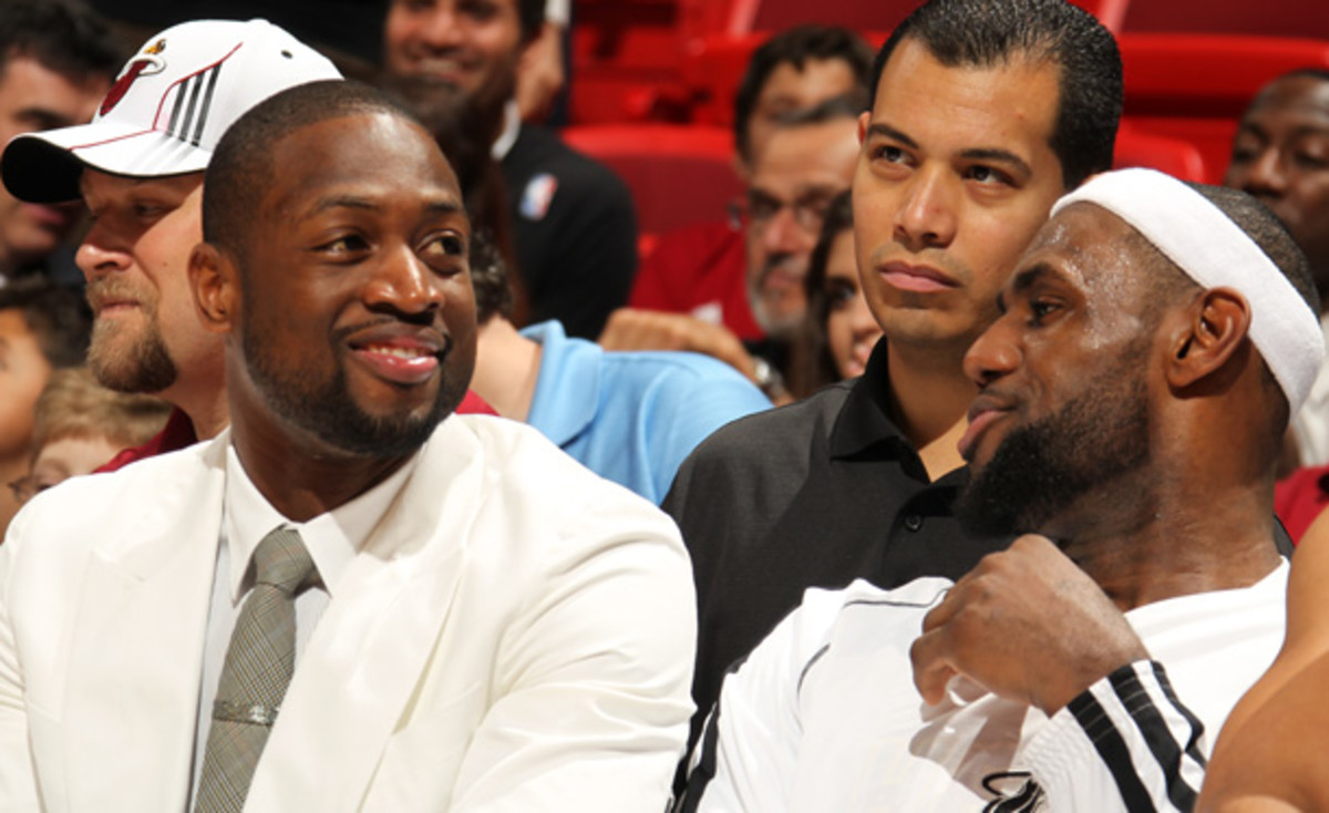 Heat stars LeBron James, right, and Dwyane Wade will sit out against the Spurs. (Issac Baldizon/Getty Images)