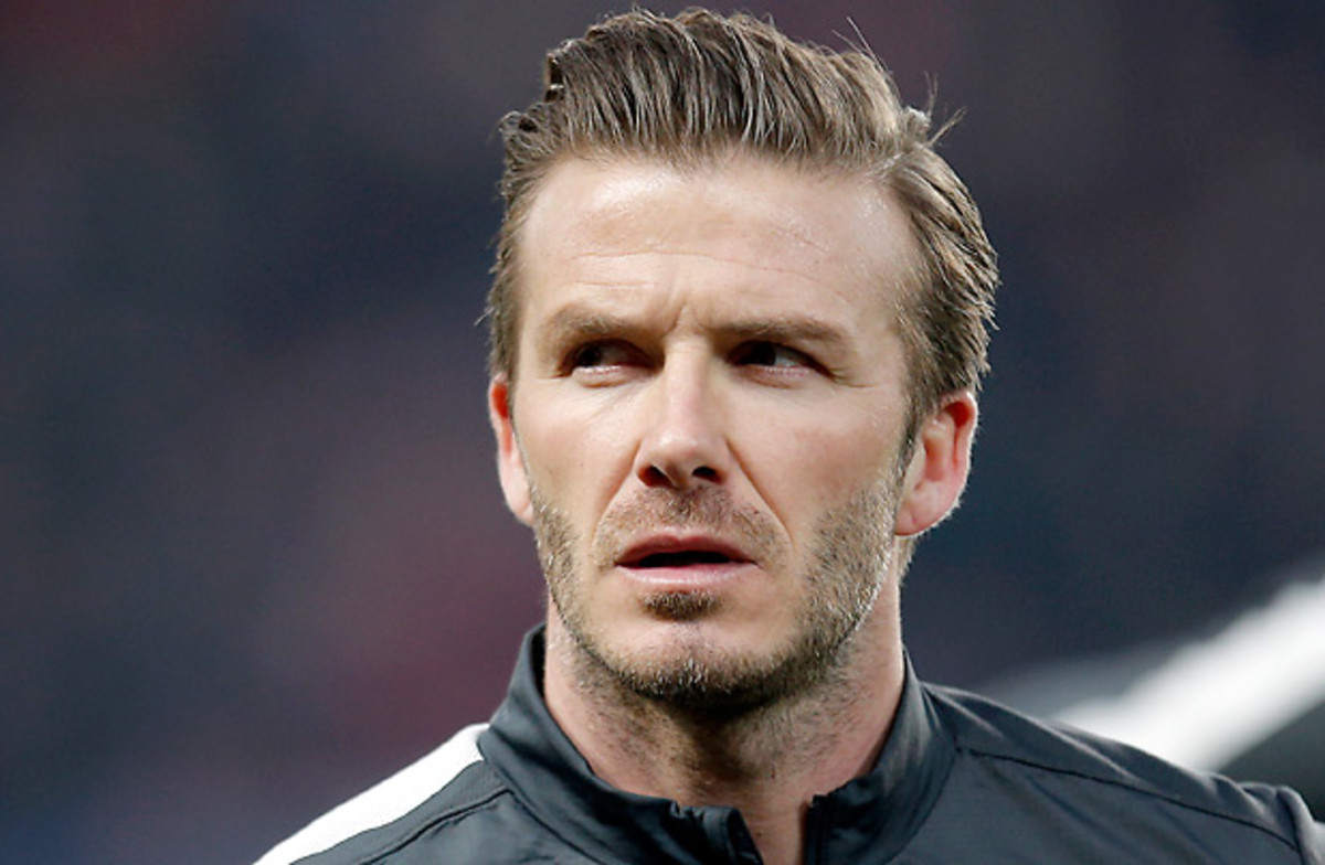 David Beckham wouldn't be the first high-profile soccer player to try a career in the NFL. (Christophe Ena/AP)