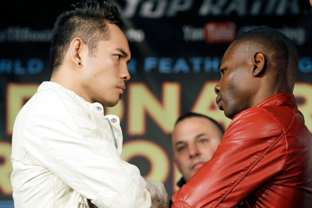 Nonito Donaire (left) and Guillermo Rigondeaux size each other up ahead of their April 13 fight. (AP)
