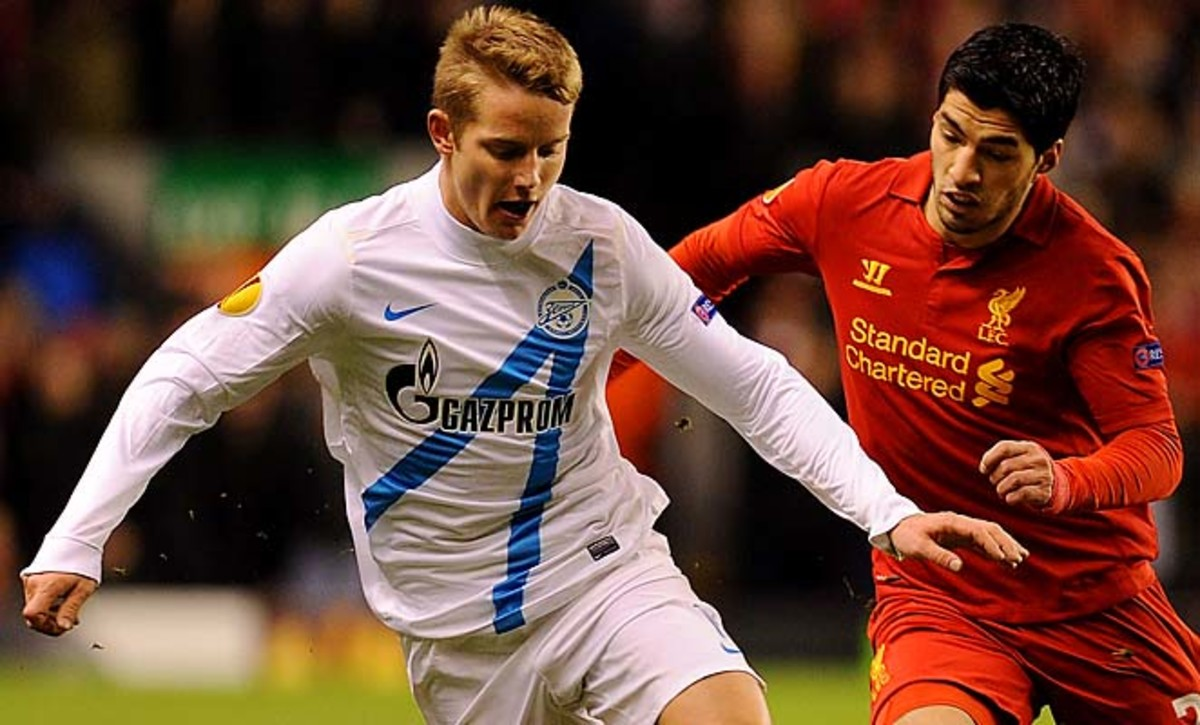 Luis Suarez (right) stepped on Tomas Hubocan's (left) back in last week's Europa League match.