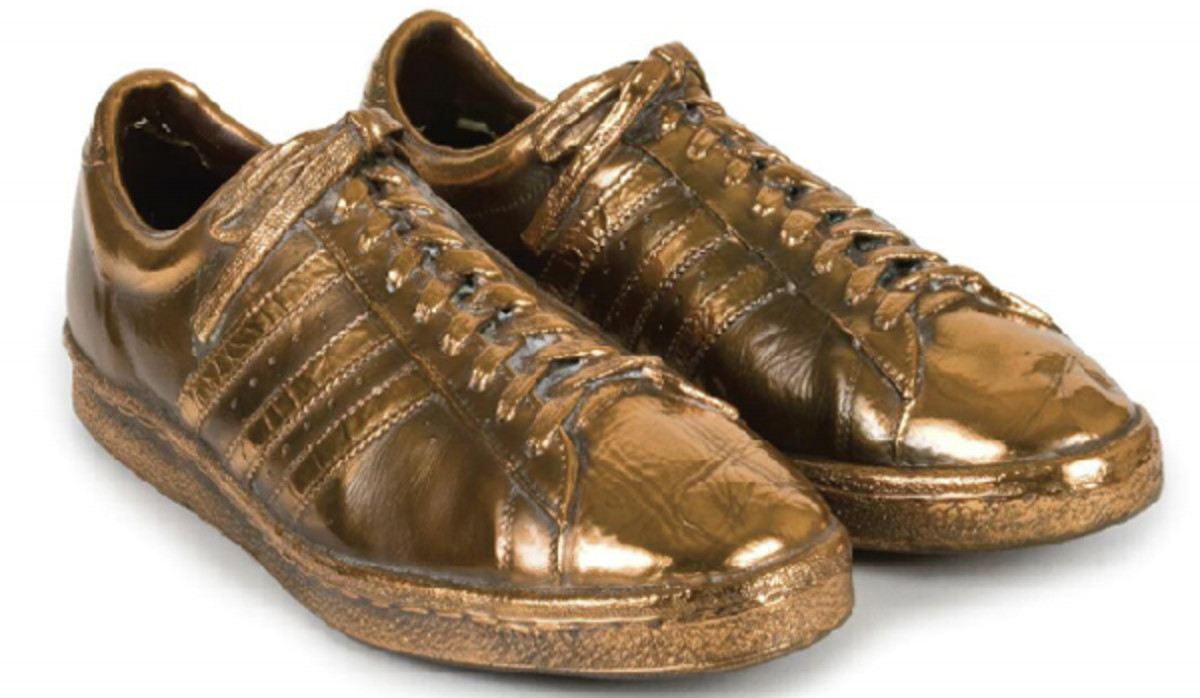Bronzed game-worn shoes given to Baylor by Merv Griffin as a retirement gift. (JuliensAuctions.com)