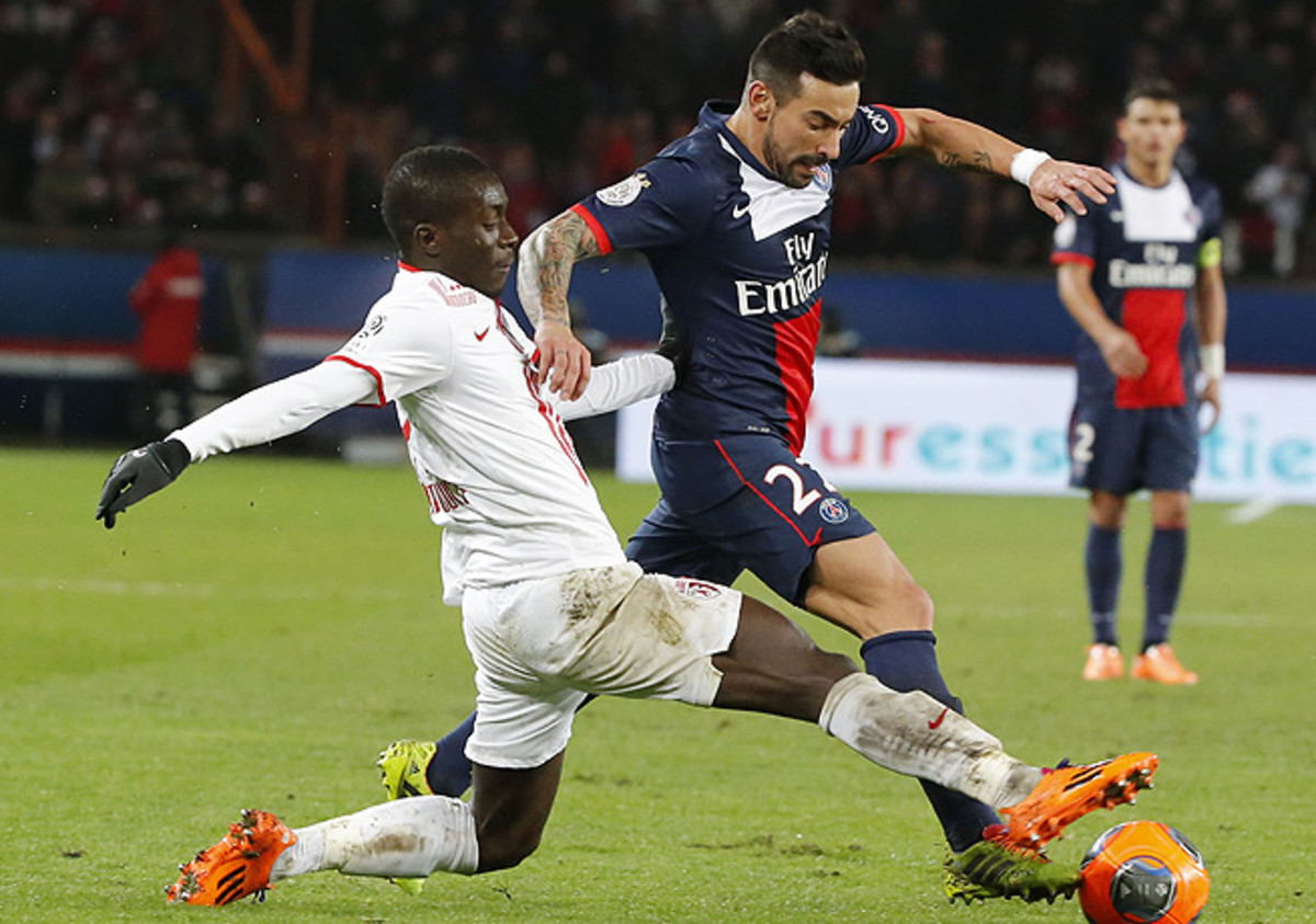 Ezequiel Lavezzi (right) and PSG are the Ligue 1 leaders at the season's midway point.