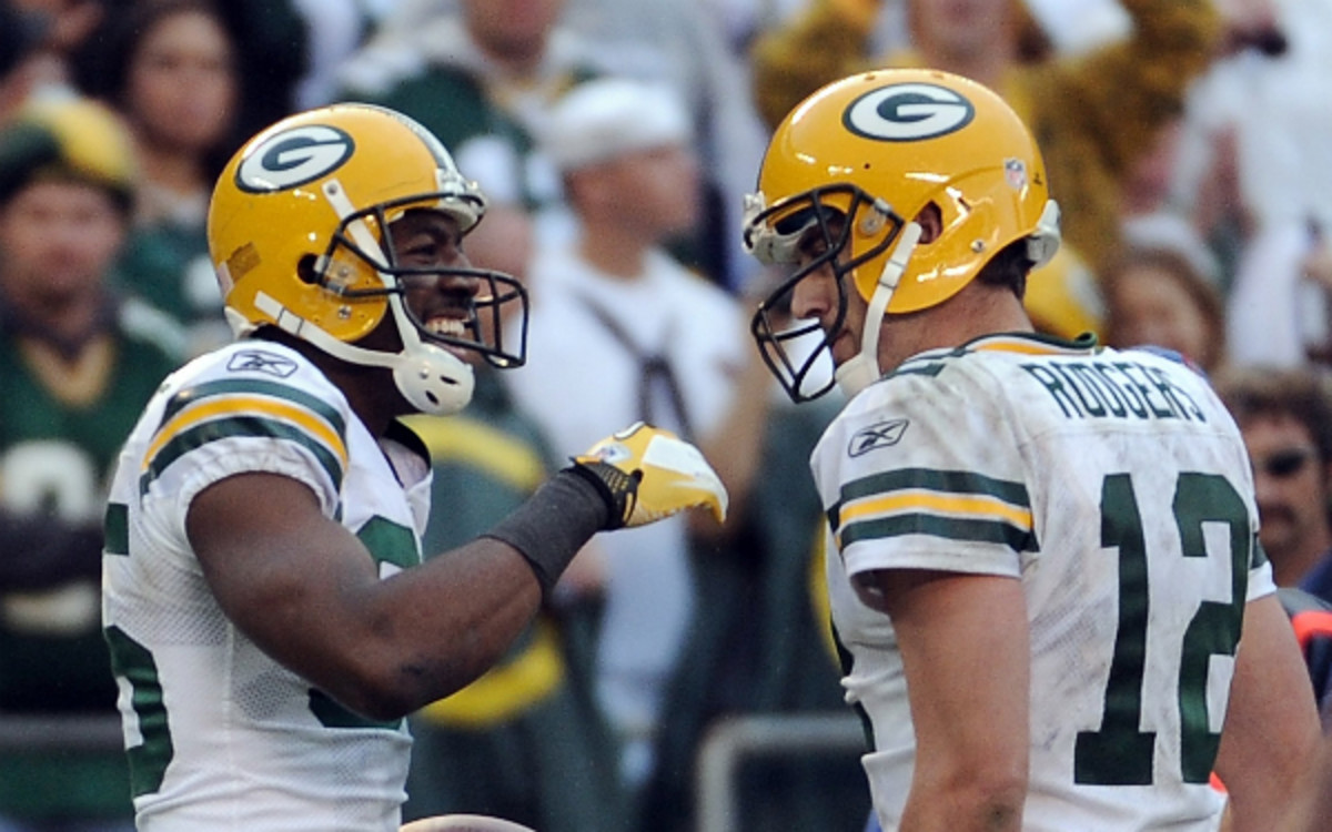 Greg Jennings and Aaron Rodgers aren't playing as nicely on separate teams. (Harry How/Getty Images)