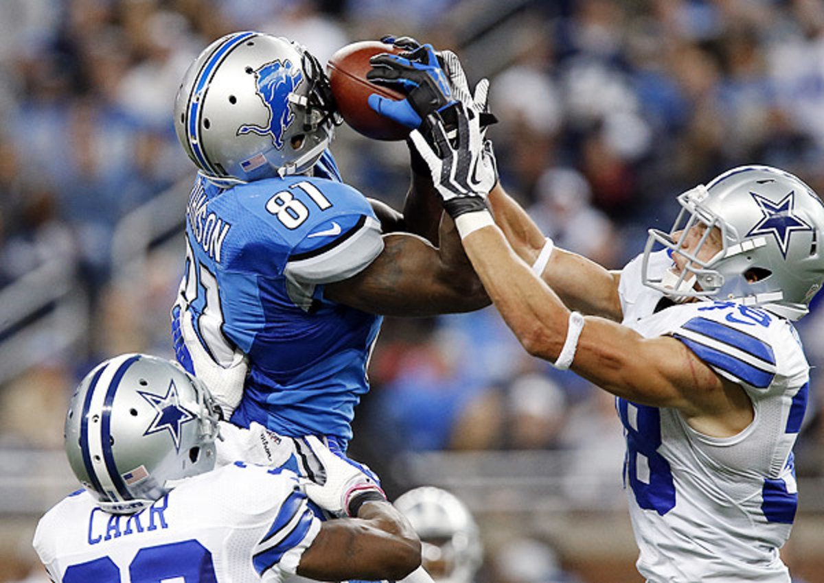 Calvin Johnson (top) fell seven yards shy of the single-game receiving record held by the Rams' Flipper Anderson.
