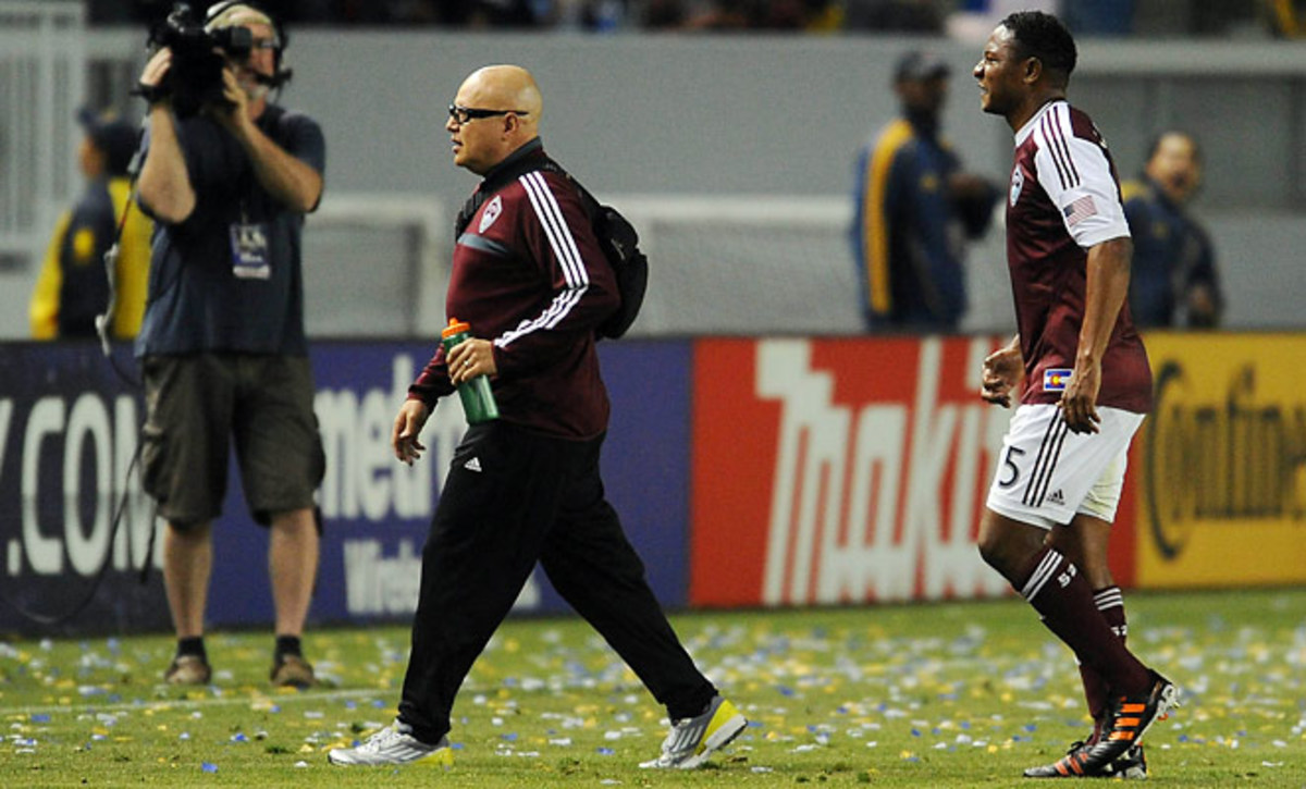 Diego Calderon leaves the field after colliding with a goalpost against the Los Angeles Galaxy.