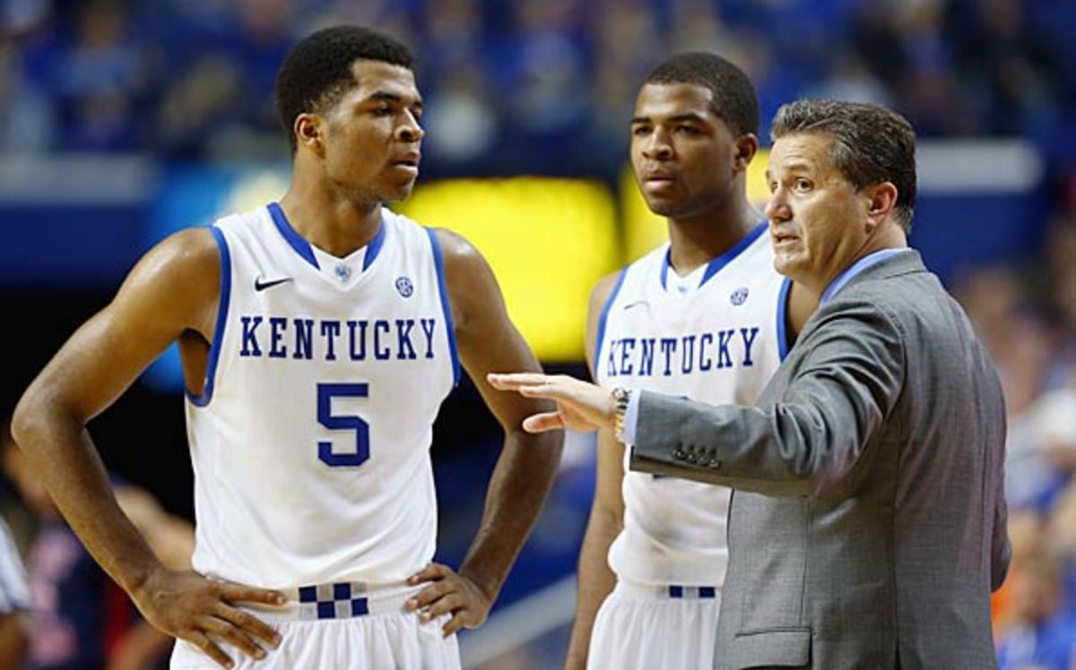 John Calipari the head coach of the Kentucky Wildcats talks with Aaron Harrison #2 and Andrew Harrison #5 during the game against the Cleveland State Vikings at Rupp Arena on November 25, 2013 in Lexington, Kentucky. (Photo by Andy Lyons/Getty Images)