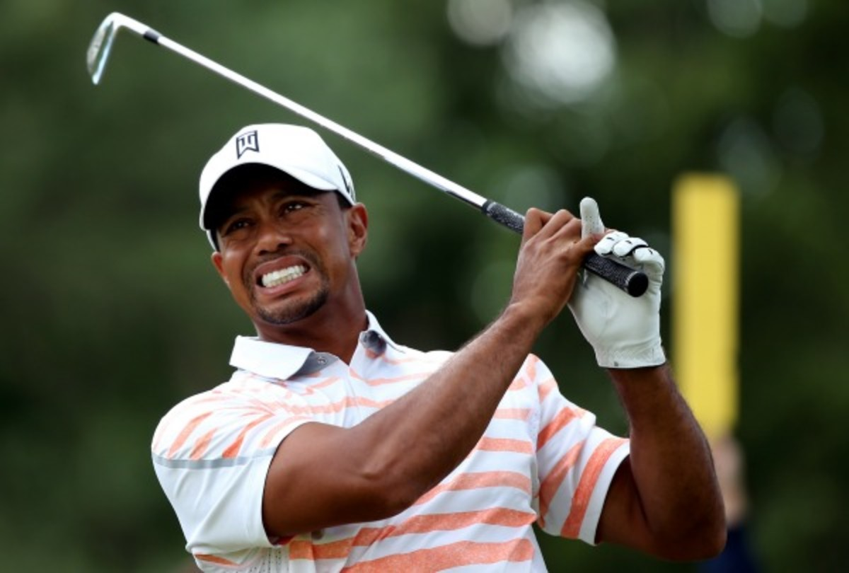 Hitting out of the U.S. Open rough worsened Tiger Woods' strained elbow. (Andrew Redington/Getty Images)