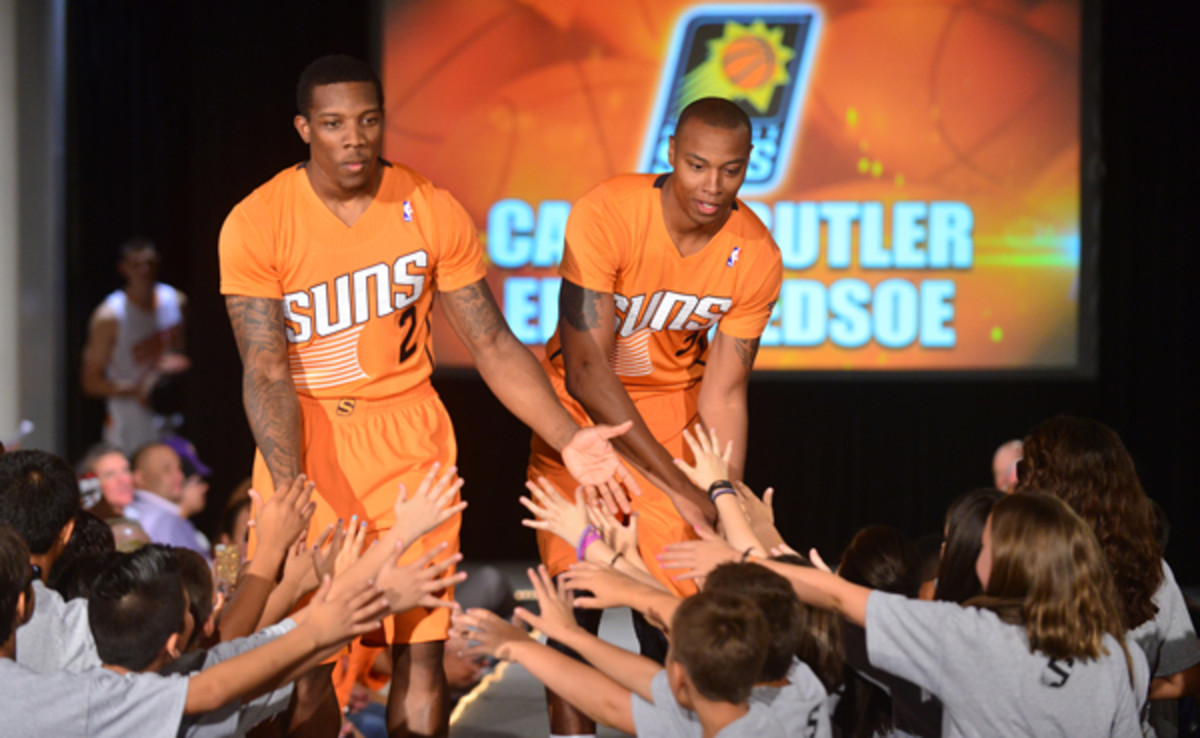 Caron Butler (right) never played in a game for the Suns but he did own the runway at a jersey unveiling fashion show. (Barry Gossage/Getty Images)