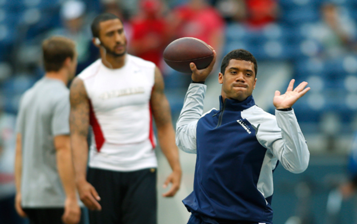 Colin Kaepernick and Russell Wilson have been asked to define their offenses this year, with varying results. (John Froschauer/AP)