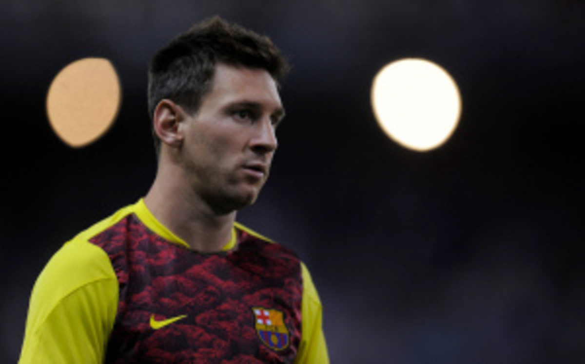 FC Barcelona's Lionel Messi is uncertain whether he will play Sunday in Malaga after suffering a bruised thigh on Wednesday. (Denis Doyle/Getty Images)