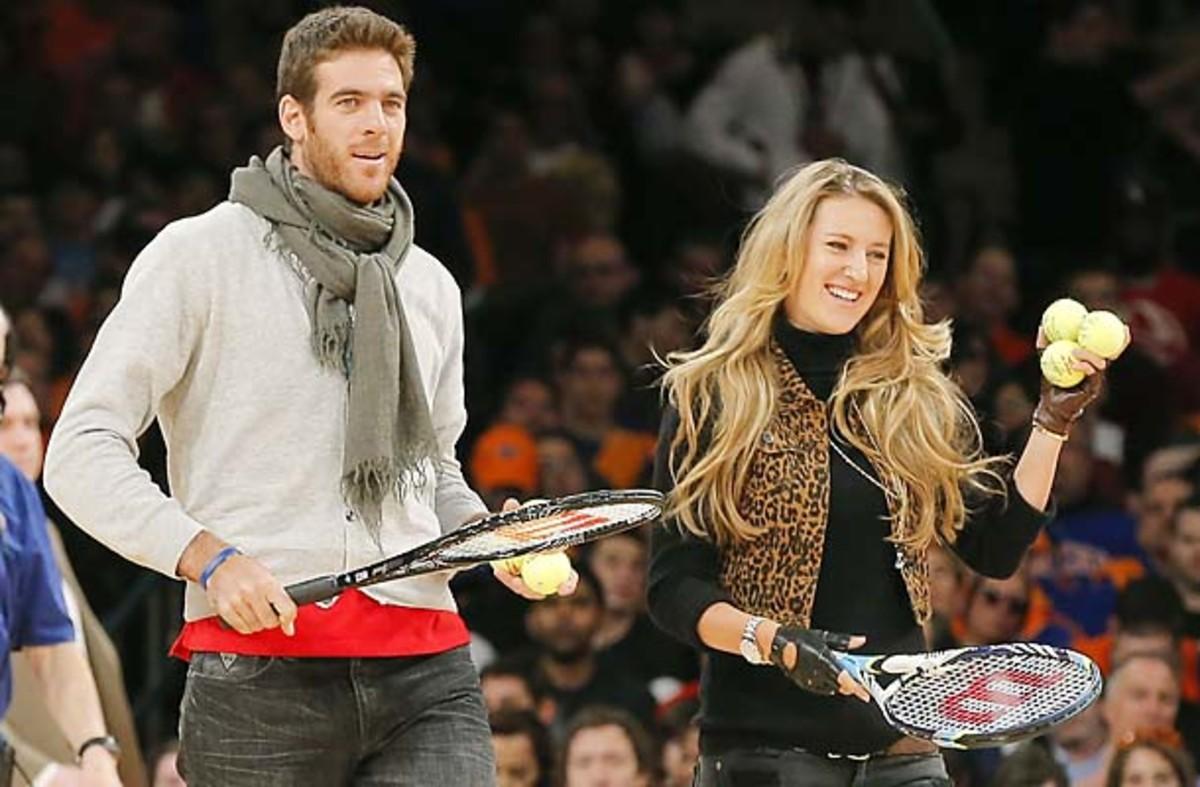 Tennis stars Del Potro and Azarenka enter court during New York Knicks NBA game with Miami Heat in New York
