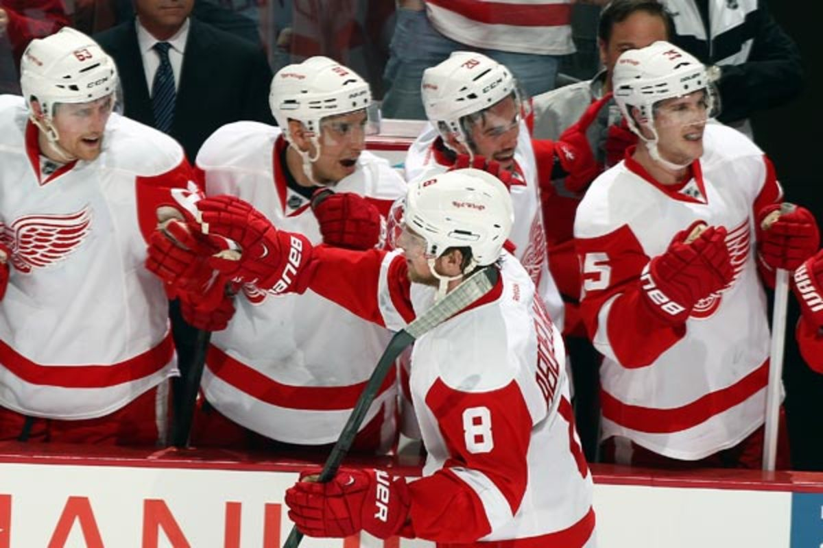 Justin Abdelkader is congratulated after completing his hat trick vs. the Ducks. (Debora Robinson/Getty Images)