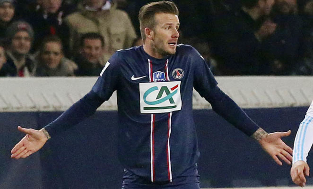David Beckham and PSG lead Ligue 1 by three points over Lyon.