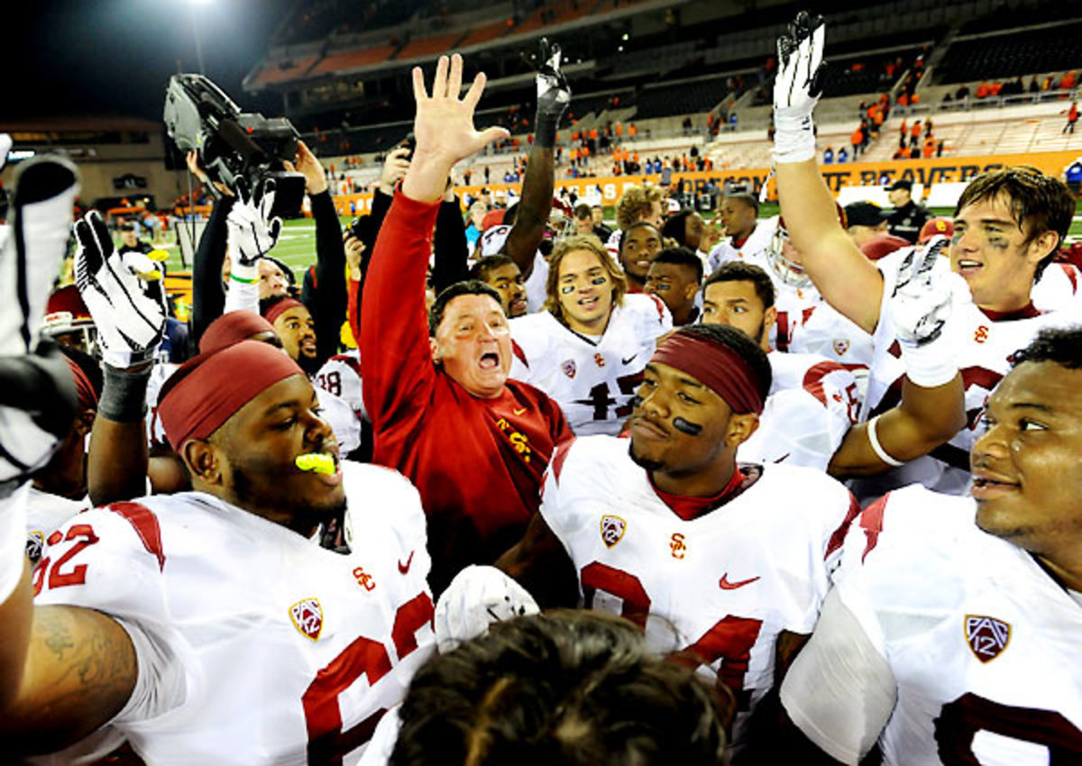 Ed Orgeron's success at USC has created a tricky situation for AD Pat Haden: Keep him or look elsewhere?