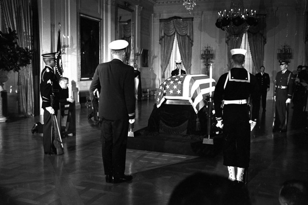 While players prepared for Sunday, the late president lay in state in the Capitol rotunda. (AP)