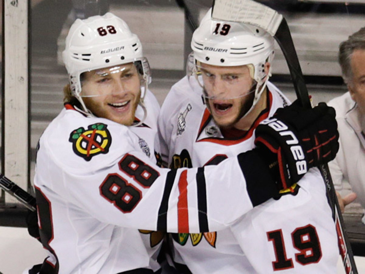 Reuniting Jonathan Toews (right) and Patrick Kane proved to be a spark for Chicago's offense in Game 4. (Charles Krupa/AP)
