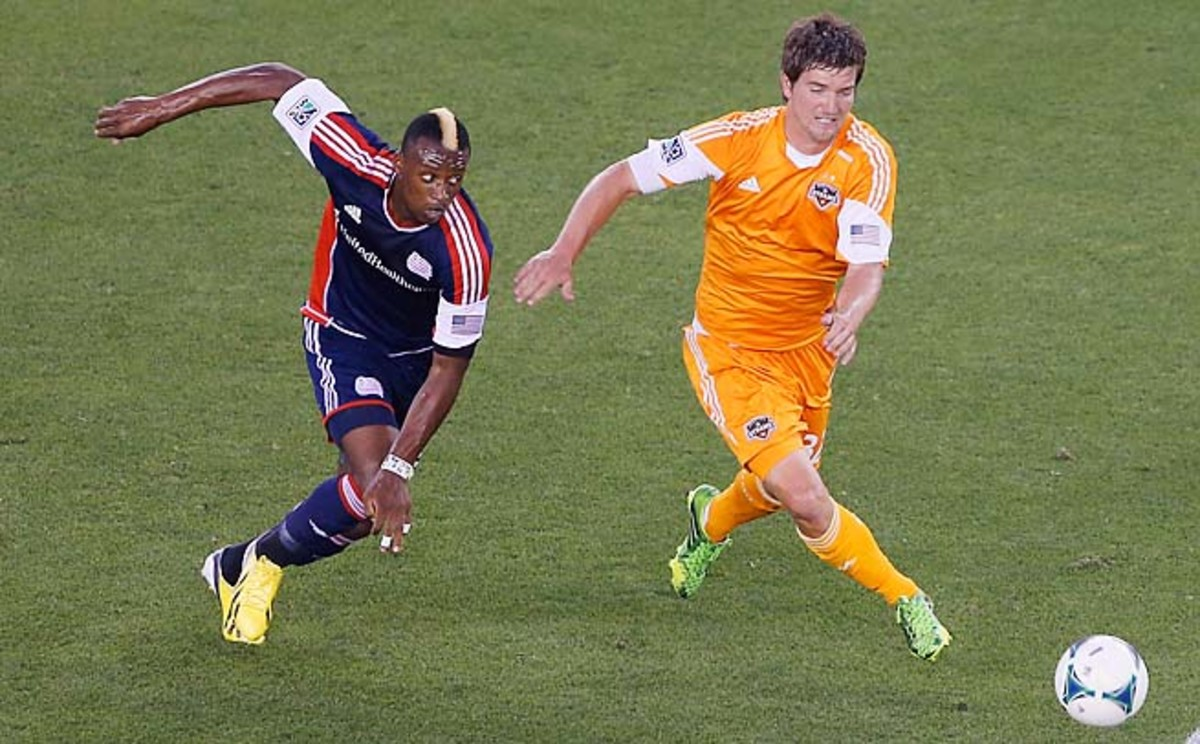 Bobby Boswell (right) and the Dynamo have 20 points in 12 games, third-best in the East.