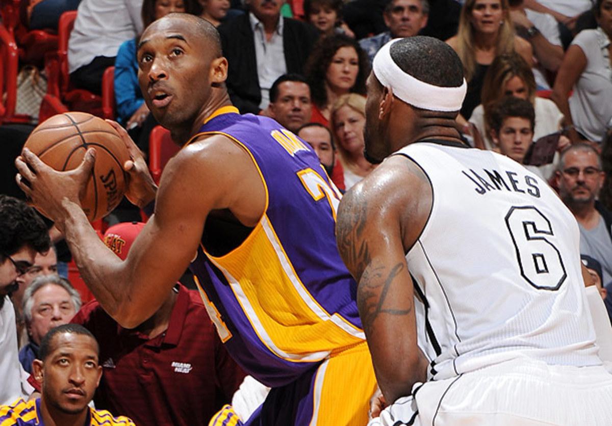 LeBron James guards Kobe Bryant