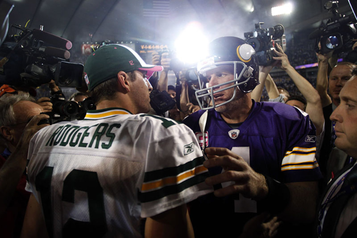Aaron Rodgers learned plenty about playing tough from Brett Favre, but he and the Green Bay decision-makers must do what's best for everyone's long-term interests. (Morry Gash/AP)