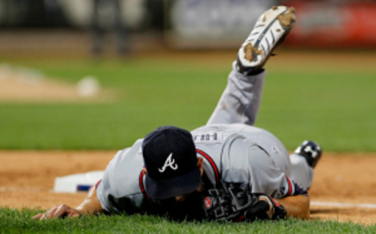 The Braves' Tim Hudson has been ruled out of the season with a broken ankle. (Mike Stobe/Getty Images)