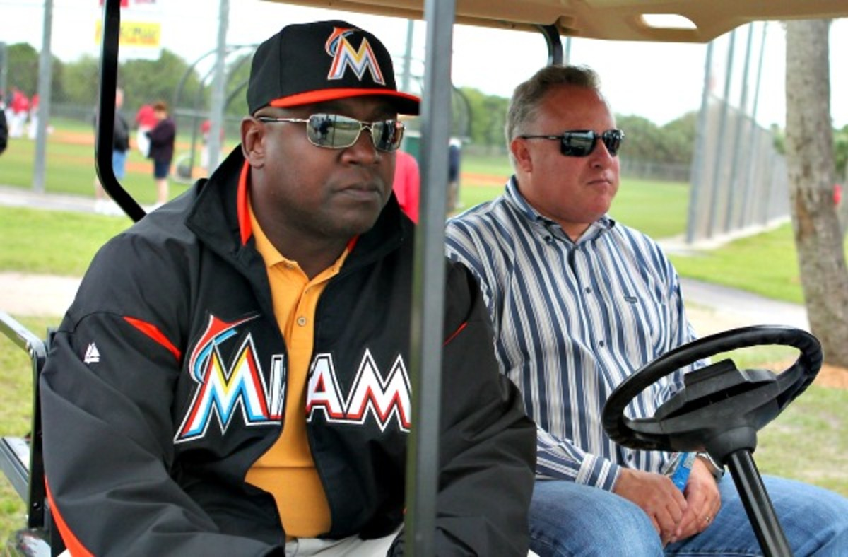 The Marlins relieved President of Baseball Operations Larry Beinfest (right) of his duties. (Getty Images)