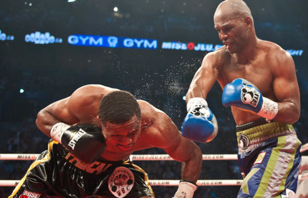 Jean Pascal (left) lost his light heavyweight title to Bernard Hopkins in 2011. (Rogerio Barbosa/AFP/Getty Images)