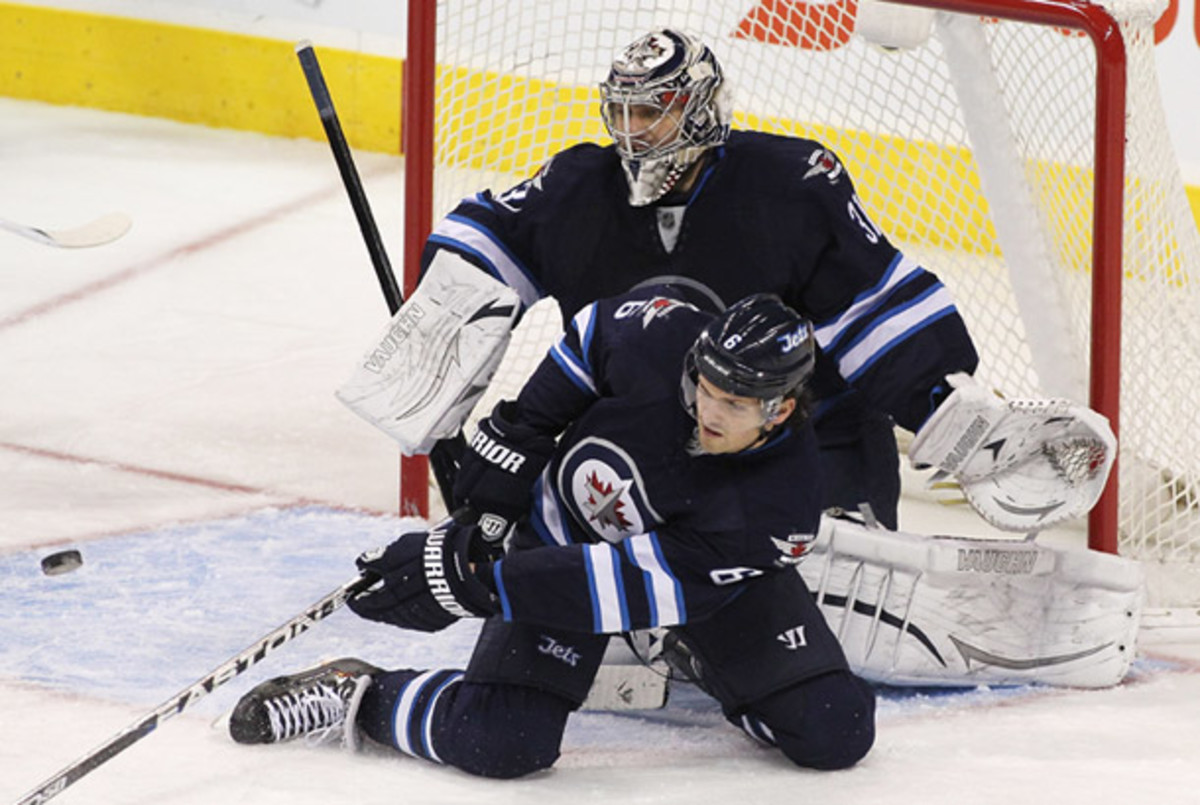 Ron Hainsey and Ondrej Pavelec of the Winnipeg Jets