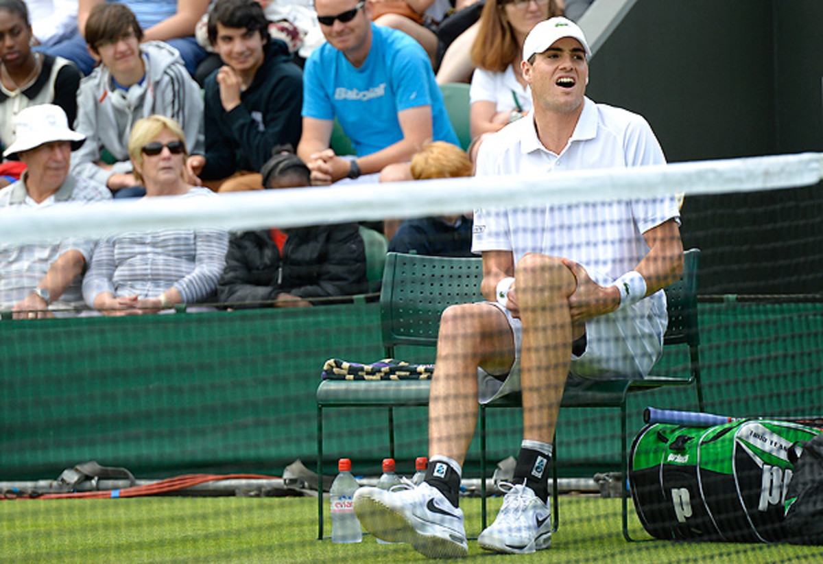 U.S.' John Isner retires after completing only two games in his second round match at Wimbledon. (ADRIAN DENNIS/AFP/Getty Images)
