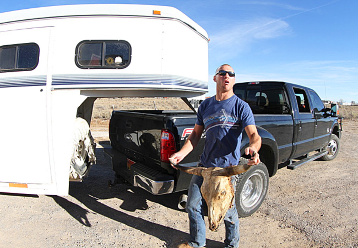 """Donald """"Cowboy"""" Cerrone works on his ranch, dubbed """"Fight Ranch"""" in Albuquerque, N.M."""