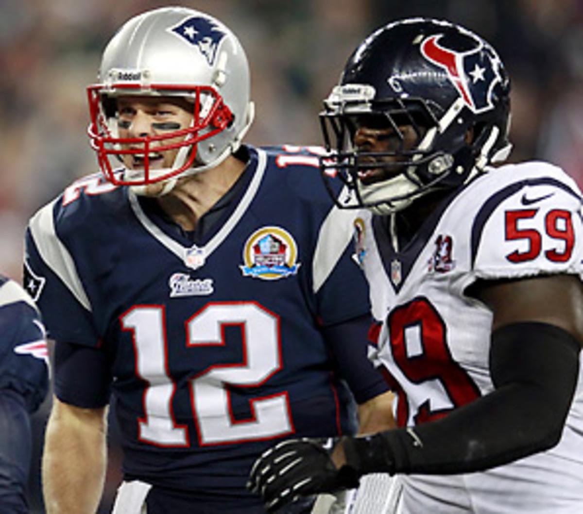 Tom Brady threw four touchdown passes against the Texans in their last meeting. (Steven Senne/AP)