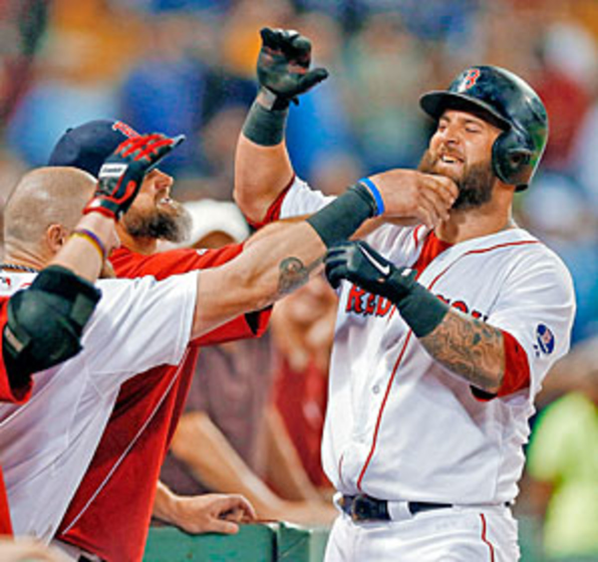 No Napoli home run is complete without a slew of celebratory tugs in the dugout.