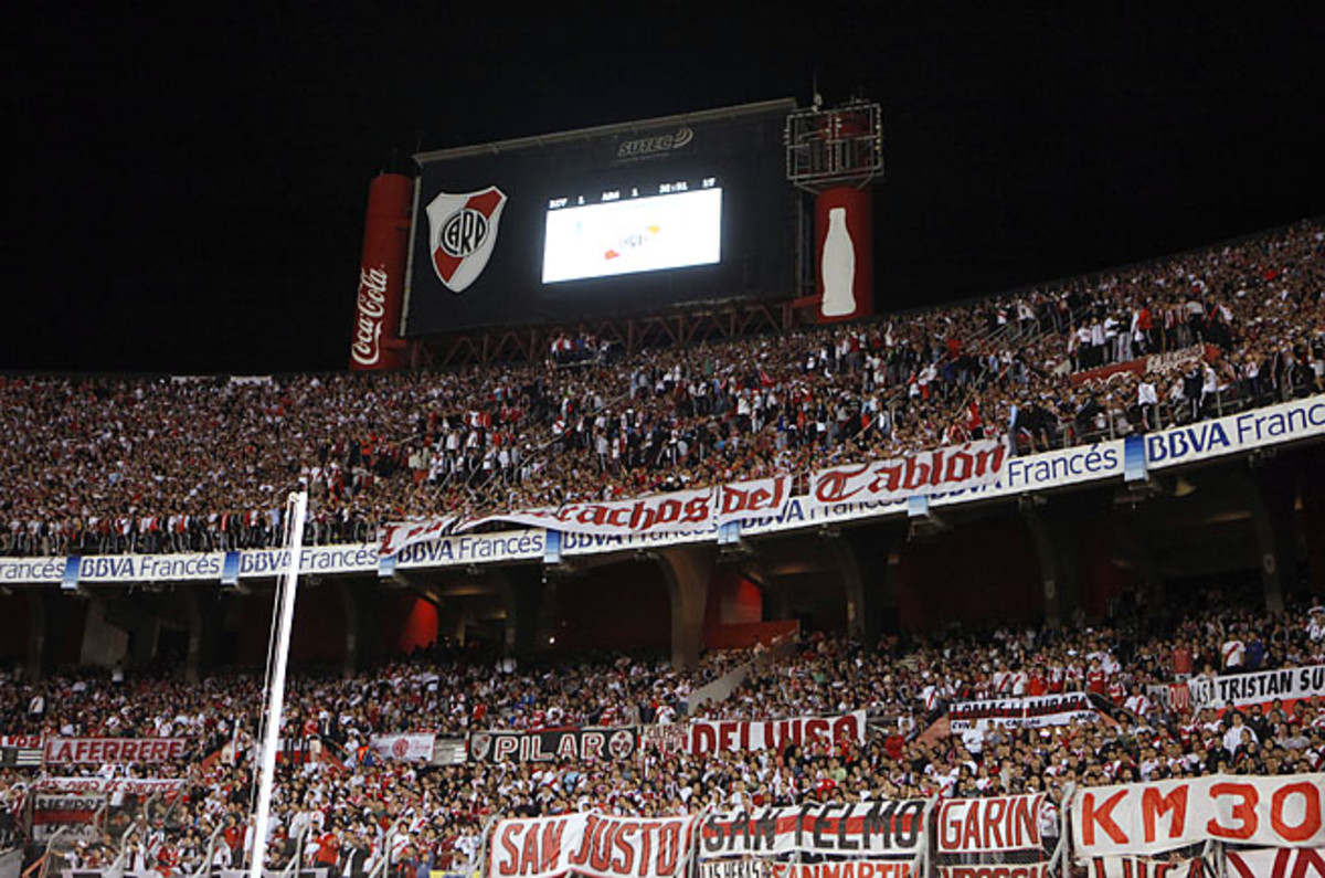 Supporters of River Plate cheer for their team at the Torneo Final Monumental stadium in April.