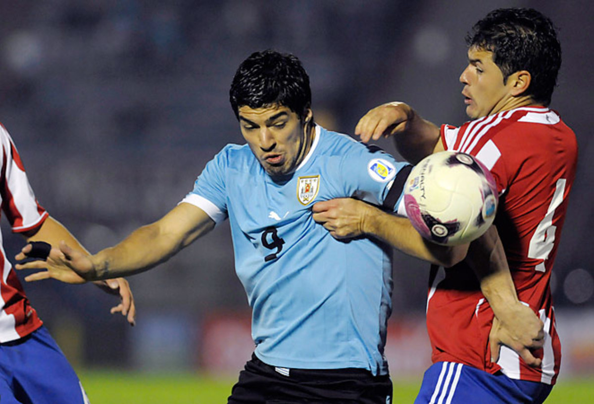 Luis Suarez scored for Uruguay but Paraguay came back to draw 1-1 in World Cup qualifying on Friday.