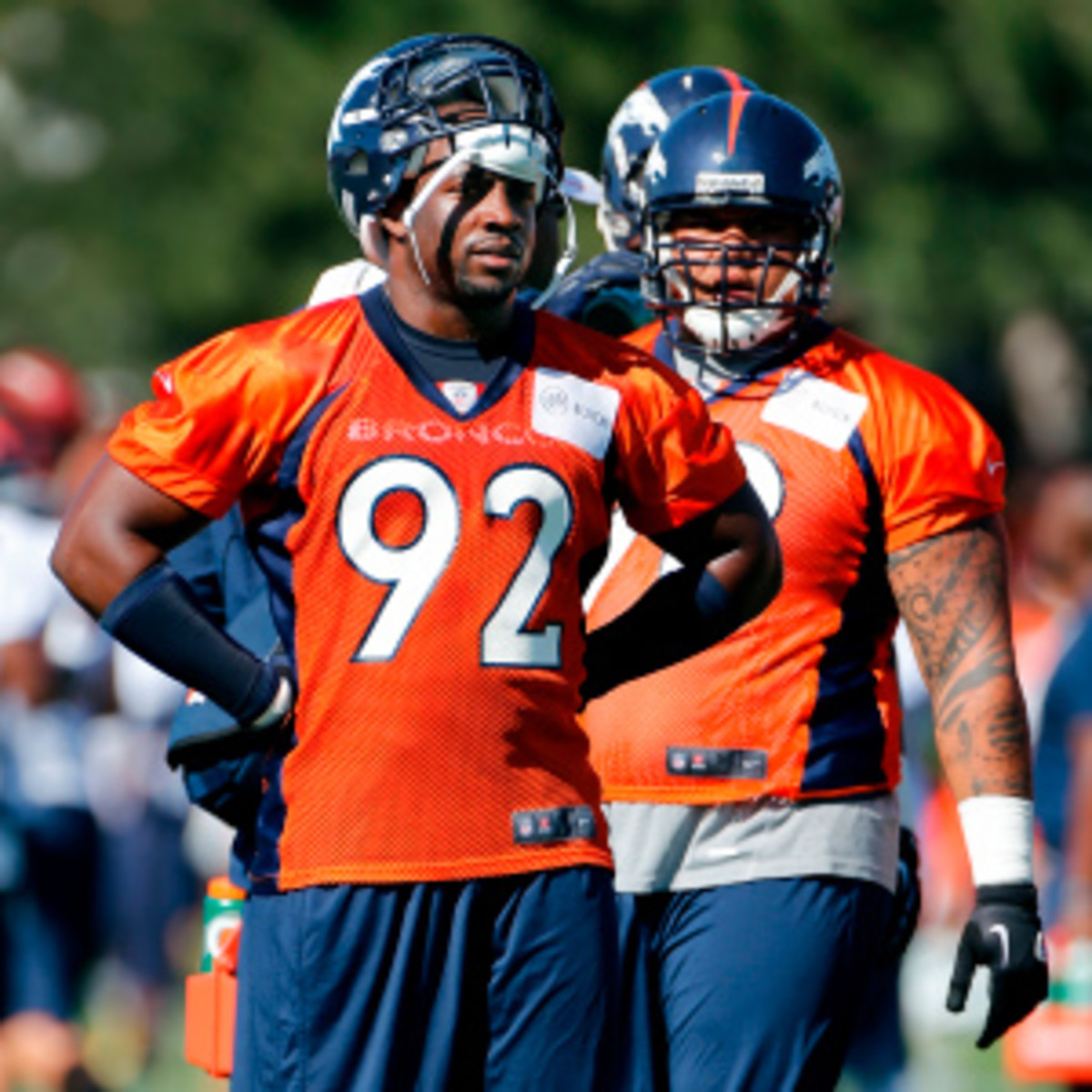 Elvis Dumervil remains in the mix for a return to the Broncos. (Doug Pensinger/Getty Images)