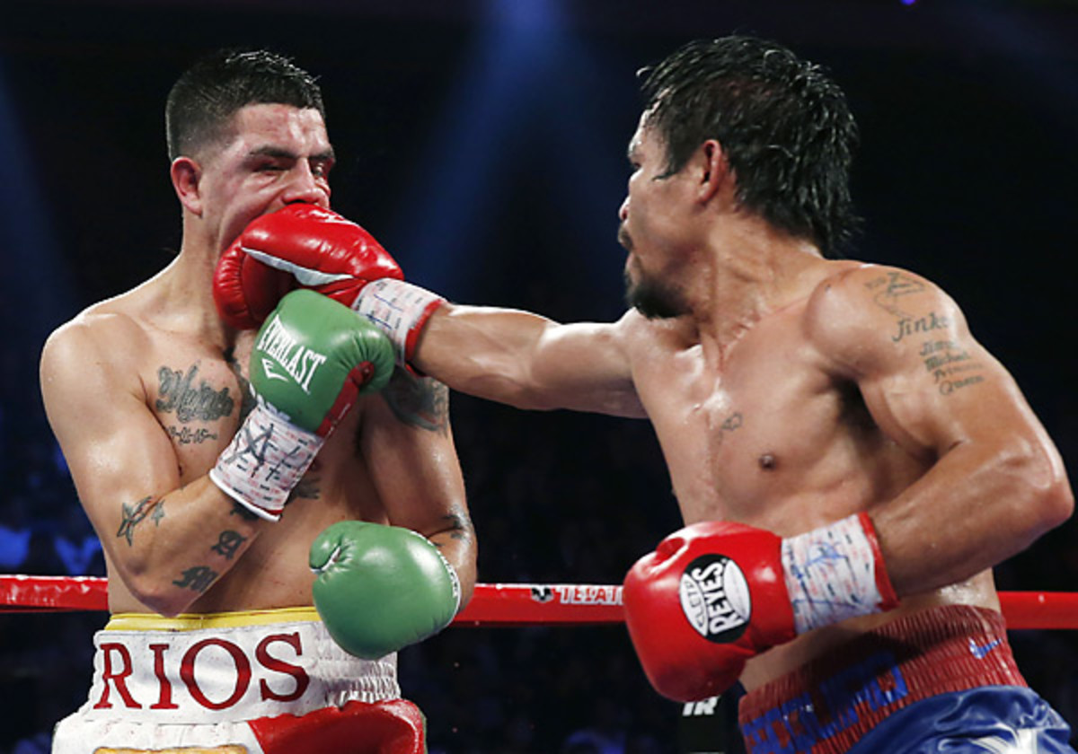 Brandon Rios (left) had trouble handling Manny Pacquiao's combination of speed and power in Macau. (Vincent Yu/AP)