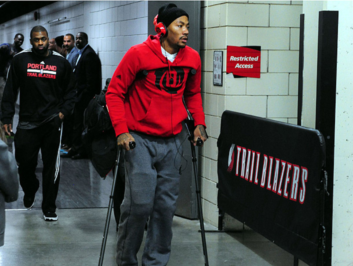 Derrick Rose left the arena on crutches after being injured on Friday night in Portland. (Steve Dykes/USA TODAY Sports)