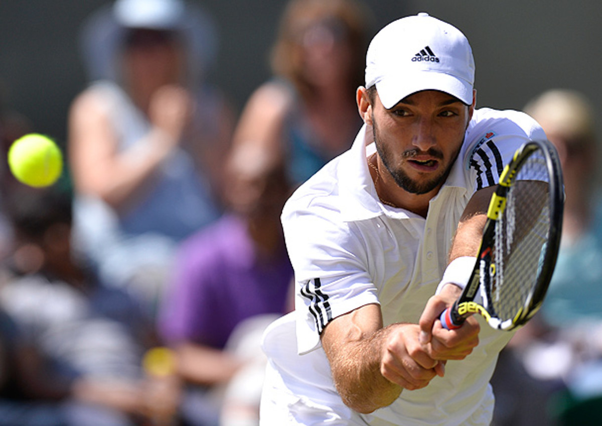 Viktor Troicki was asked for a urine and blood sample for a doping test, and he refused to give the blood sample. (Adrian Dennis/Getty Images)