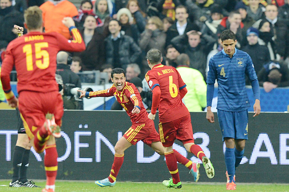 Spain's Pedro scored the only goal of the game, securing Spain's one point lead over France in Group I.