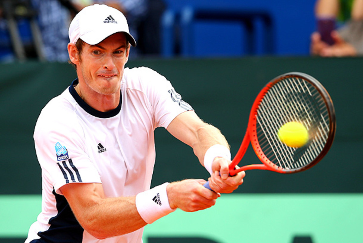 Andy Murray is taking time off to deal with his lingering back pain. (Julian Finney/Getty Images)