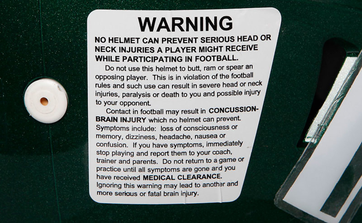 The warning sticker on the back of a helmet. (Taylor Ballantyne/SI)