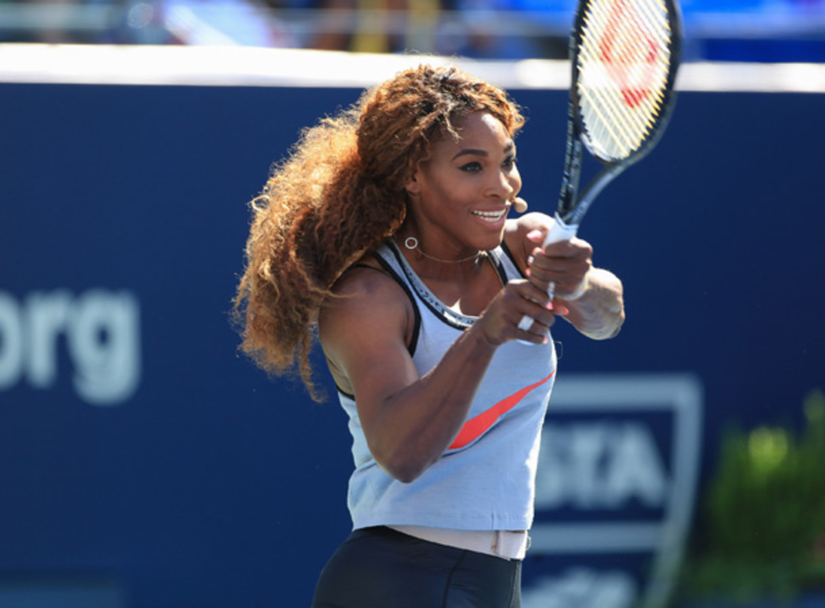 Serena Williams was all smiles at the skills challenge on Saturday. She opens on Monday. [Charles Norfleet/Getty Images]
