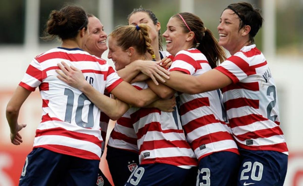 Rachel Buehler (third from left) celebrates after scoring the opening goal against Iceland.