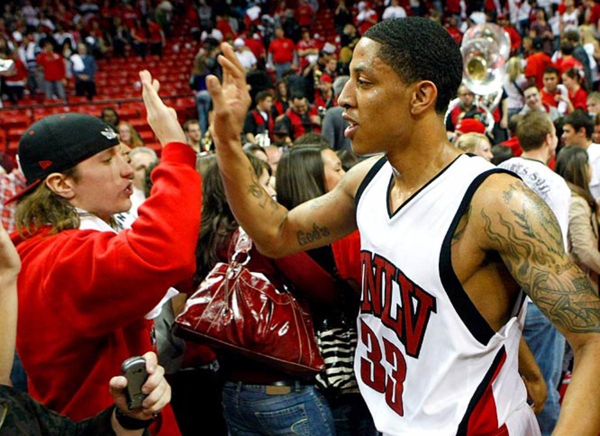 Wyoming at UNLV, Tre'Von Willis high-fives a fan.