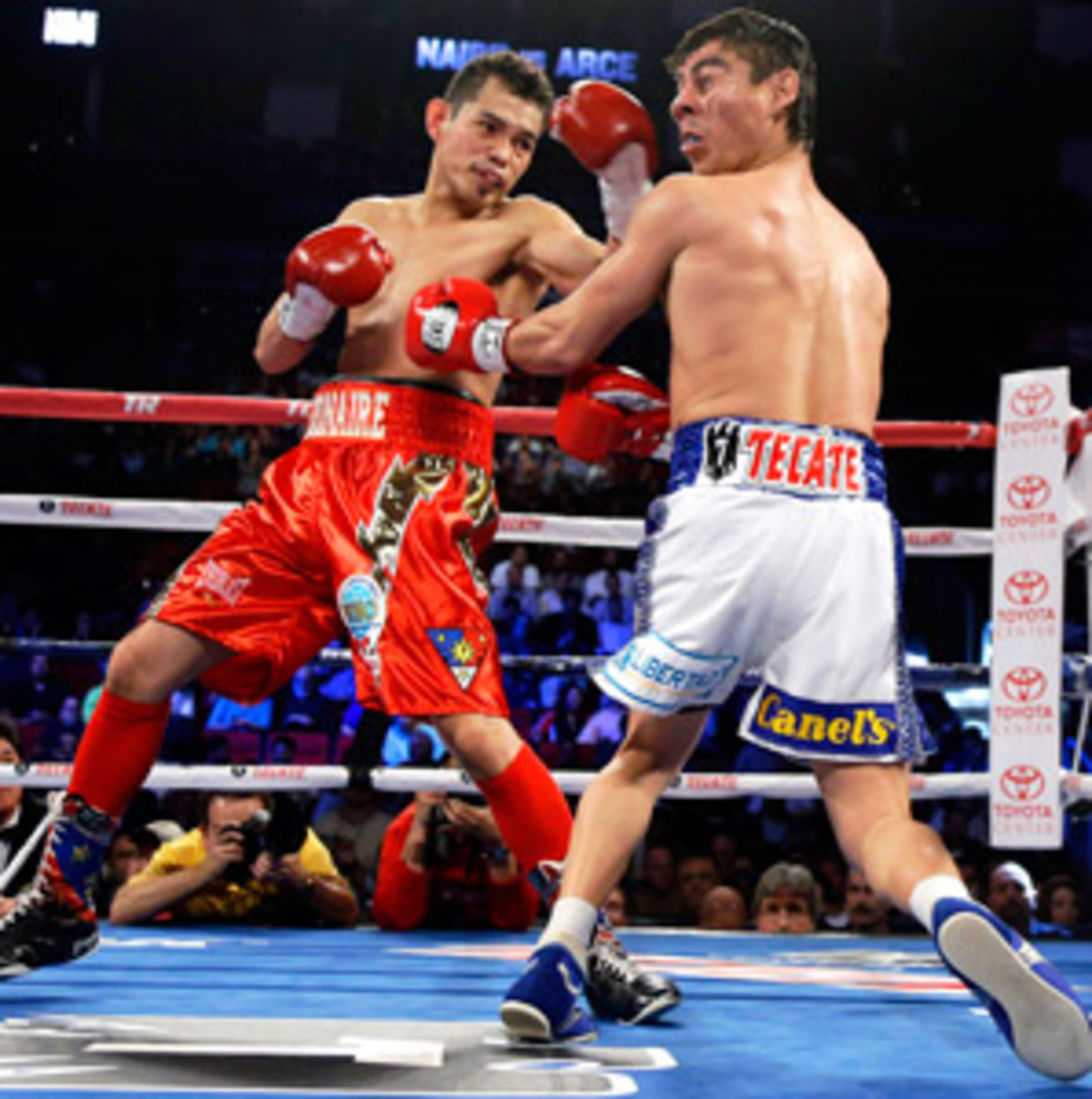 Nonito Donaire (left) scored his 20th career knockout against Jorge Arce.