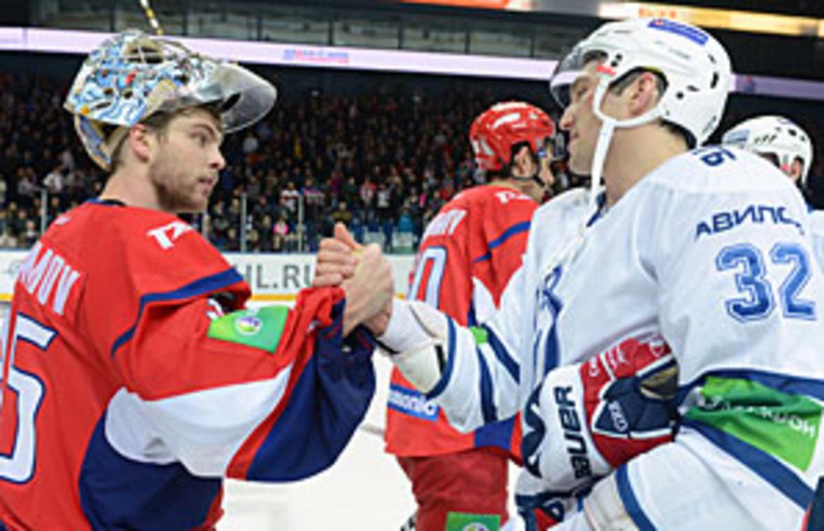 Semyon Varlamov (left) of the Avalanche is tending goal for the KHL's reborn Lokomotiv Yaroslavl a year after its tragic plane crash.