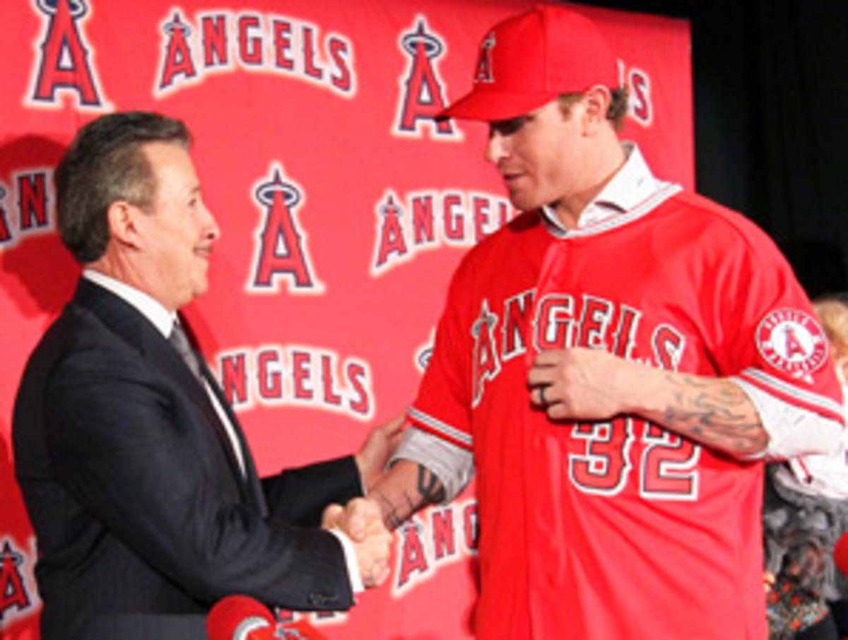 Angels owner Arte Moreno (left) brings Josh Hamilton to L.A. after signing Albert Pujols last season.