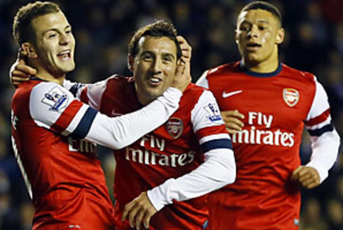 Jack Wilshere (left), Santi Cazorla (center) and Alex Oxlade-Chamberlain celebrate one of Arsenal's five goals.
