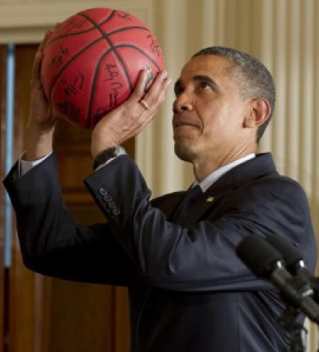 US President Barack Obama pretends to sh