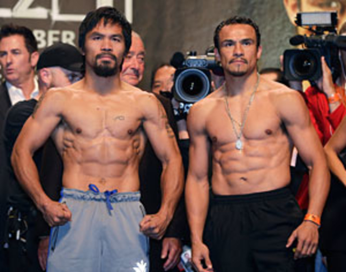 Manny Pacquiao (left) and Juan Manuel Marquez (right) both made weight for Saturday's welterweight showdown, their fourth meeting in eight years.(AP)