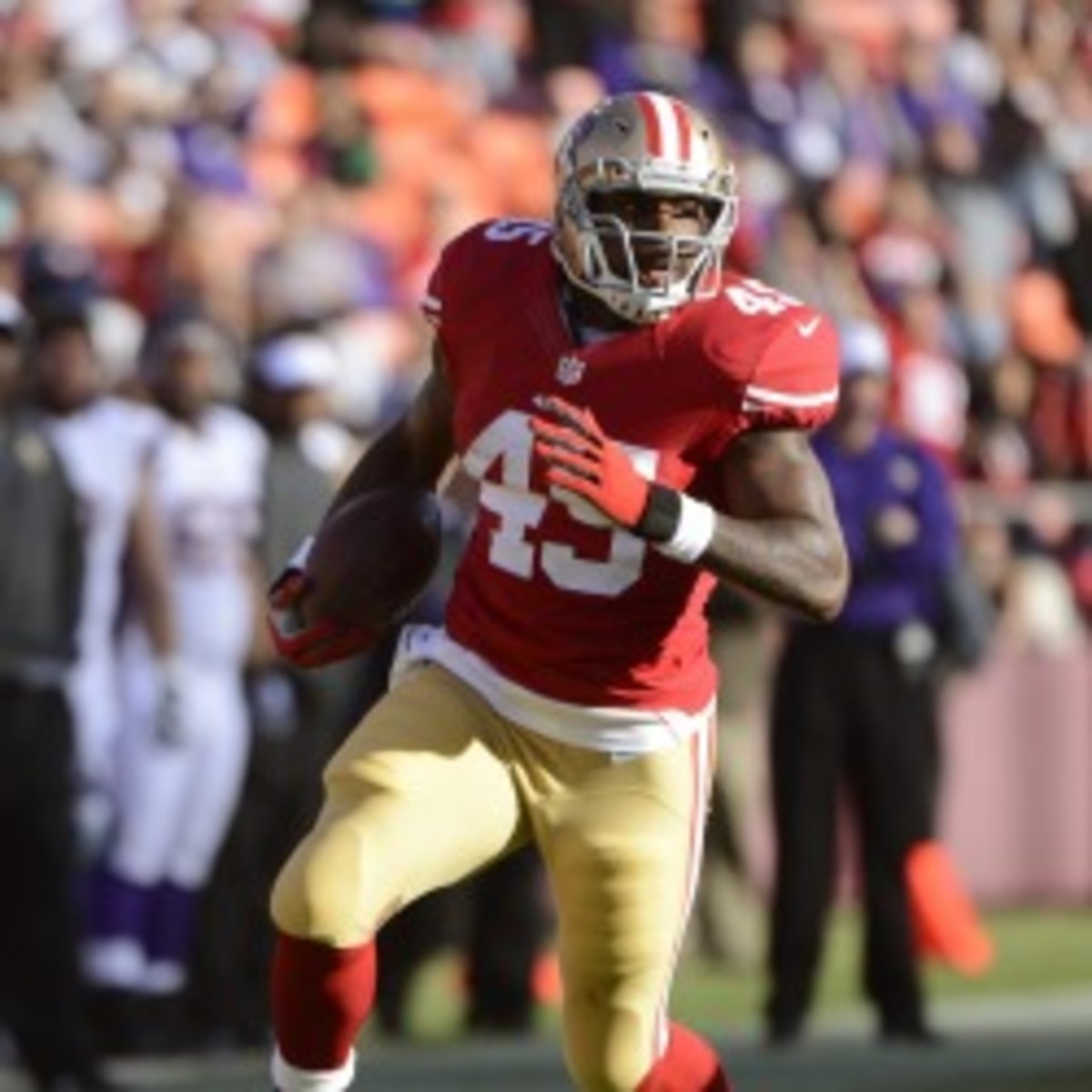 49ers running back Brandon Jacobs has carried the ball only five times this season. (Thearon W. Henderson/Getty Images)